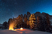 Camp area with campfire in front of the Villnoesser Geisler, Grupp delle Odle, Dolomites, Unesco world heritage, Italy