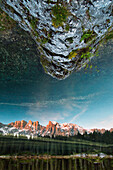 Lake Karersee reflecting the Rosengarten mountain range, Dolomites, Unesco world heritage, South Tyrol, Italy