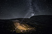 Hiker enjoying a nightly view in the area of the Fanes Alm mountain pasture, in heart of the Dolomites, Unesco world heritage, in Gader Valley, South Tyrol, Italy