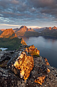 View from the top of Segla to the island of Senja with over 1000 m high mountains on the shores of Mefjorden in the last evening light, Fylke Troms, Norway, Scandinavia