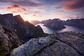 Impressive Sunset above the Lofoten island Moskenesøy seen from the summit of Reinebringen, Kjerkfjorden, Norway, Scandinavia