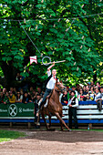 Castelrotto, South Tyrol, Italy. The traditional ring jousting at the Monte Calvario