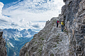 Stubai Alps, Tyrol, Austria. Climbers on the via ferrata of the Ilmspitze.