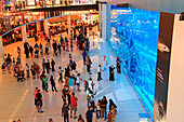 Downtown Burj Dubai in Dubai, United Arab Emirates. Aquarium in Dubai Mall - world's largest shopping mall. People enjoying the beautiful view.