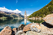The famous old church tower of Graun in the Reschensee, Graun, Vinschgau, Südtriol, Alto Adige, Italy
