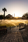 In the Sultan Ahmet Park park at the Hagia Sophia the lawn is watered during the sunrise, Istanbul, Turkey