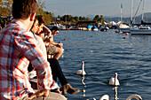 Late summer crowds on Quaianlage, Lake Zurich, Zurich, Switzerland