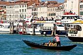 Gondola and gondolier, Palaces facades,boats and vaporetto, Canal Grande, Venice, Venetia, Italy.