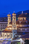 Albania, Korca, the Orthodox Cathedral, elevated view along the Boulevard Republika, dusk.