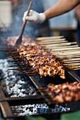 Australia, Victoria, VIC, Melbourne, Queen Victoria Market, ethnic food market, grilled food.