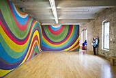 USA, Massachusetts, North Adams, Mass MOCA, Massachusetts Museum of Contemporary Art, former mill buildings converted into art museum, paintings by Sol LeWitt.