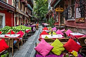 Colorful restaurants with tables and chairs and the unique Cezayir or French Street in Taksim, Istanbul, Turkey, Eurasia.
