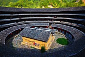 China, Fujian province, Chuxi village, Tulou mud house. well known as the Hakka Tulou region, in Fujian. In 2008, UNESCO granted the Tulou ´´Apartments´´ World Heritage Status, siting the buildings as exceptional examples of a building tradition and funct