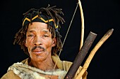 Portrait of Naro San Bushman, wearing traditional clothing and headband, Kalahari, Ghanzi region Botswana, Africa.