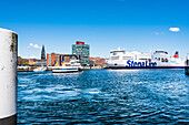 The ferry to Sweden and the passenger ferry on the Kieler Förde in the harbour with the city hall tower, Kiel, Schleswig Holstein, Germany