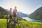 Couple with mountainbike looking in the valley