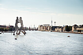 view across Spree river to artwork Molecule Man of sculpter Jonathan Borofsky, Berlin TV tower, Berlin, Germany