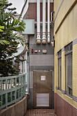back door scene with pipes and tiles at Tin Shu Wai, Hongkong, China, Asia