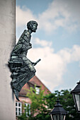 a figure with a letter in his hand is mounted at a wall, Nuremberg, Frankonia Region, Bavaria, Germany