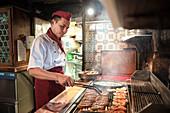 preparation of typical Nuremberg sausages, Nuremberg, Frankonia Region, Bavaria, Germany