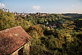 view across Tauber valley towards medieval town Rothenburg ob der Tauber, romantic Frakonia, Bavaria, Germany