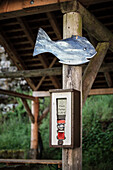 vending machine for the sale of fish feed, happy fish displayed, Wimsen Cave, Swabian Alb, Baden-Wuerttemberg, Germany