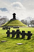 Central Tumulus Tomb and war graves at the German military cemetery at La Cambe, Normandy, France, Europe.