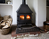 Warm flames of cosy multi-fuel burner fire stove in domestic home, UK