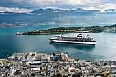 Cruiseliner Celebrity Celebration leaving the port of Alesund, Moere og Romsdal, Norway.