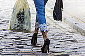 Local woman with shopping bags and high heels, Riga, Latvia.