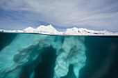 Above and below view of glacial ice near Wiencke Island, Neumayer Channel, Antarctica.