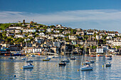 Early morning light on small boats at anchor in the harbor at Fohey, Foy, Cornwall, England.