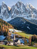 The church Sankt Magdalena in the Villnoess valley in the Dolomites during autumn.The peaks of the Geisler Mountain Range (Gruppo delle Odle), which is part of the UNESCO world heritage site Dolomites. Europe, Central Europe, Italy, South Tyrol, Alto Adig