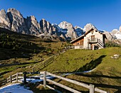 Geisler mountain range - Odle in the Dolomites of the Groeden Valley - Val Gardena in South Tyrol - Alto Adige. Foreground a mountain hut near the Regensburger Huette. The Dolomites are listed as UNESCO World heritage. europe, central europe, italy, octob