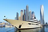 Skyline and yachts during Dubai International Boat Show 2014 United Arab Emirates.