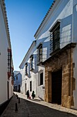 Casa Antigua del Ave Maria, typical Mediterranean architecture with whitewashed walls and narrow streets in the historical city of Carmona, province of Seville, Spain.