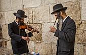 Orthodox Jews preaching as street musicians, in Jaffa gate , Old City, Jerusalem, Israel.