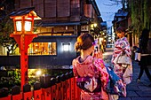 women dressed in kimono, in Shirakawa-minami-dori, Gion district, Kyoto. Kansai, Japan.