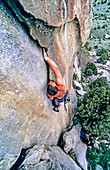 Rock climbing a route called Shake n Flake which is rated 5,10 and located on the Comp Wall at Castle Rocks State Park near the town of Almo in southern Idaho.