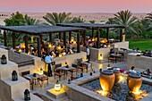 Dusk at rooftop bar at Bab al Shams desert hotel and resort in Dubai United Arab Emirates.