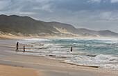 People bathing in the Indian Ocean in iSimangaliso-Wetland Park, South Africa, Africa