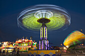 The colorfully illuminated Yo Yo spins on the midway at the Tennessee State Fair on September 5, 2014 at the Tennessee Fairgrounds in Nashville, Tennessee.