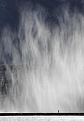 Single person taking picture of famous fountain on Geneva Lake Jet d´Eau, Geneva, Switzerland.