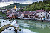 The weir and remains of a medieval bridge on the River Loue, Lods, Franche-Comté, France, Europe.