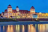 View over the Baltic Sea at night to the Kurhaus Binz. The Kurhaus Binz was opened on July 22, 1890. Today it is a luxury hotel on the Baltic Sea, Baltic resort Binz, Ruegen Island, County Vorpommern-Ruegen, Mecklenburg-Western Pomerania, Germany, Europe.
