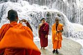 Asia. South-East Asia. Laos. Province of Luang Prabang. Monks at Kuang Si Waterfall.