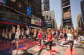 Thousands of yoga practitioners pack Times Square in New York to participate in a Power Yoga class on the first day of summer. The 12th annual Solstice in Times Square, ´´Mind Over Madness´´, stretches the yogis´ ability to block out the noise and the vis