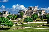 Tourists visiting the ruins of the Mayan temple grounds at Tulum, Quintana Roo, Yucatan, Mexico.