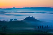 Belvedere and countryside at dawn, San Quirico d´Orcia, Tuscany, Italy.