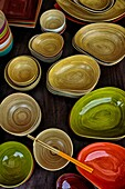 Highly polished and colourful bamboo wooden bowls, dishes and general household utensils. Thailand S. E. Asia.